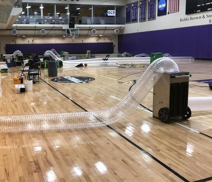 Drying gymnasium floor using an Inject-I-Dry Sysytem