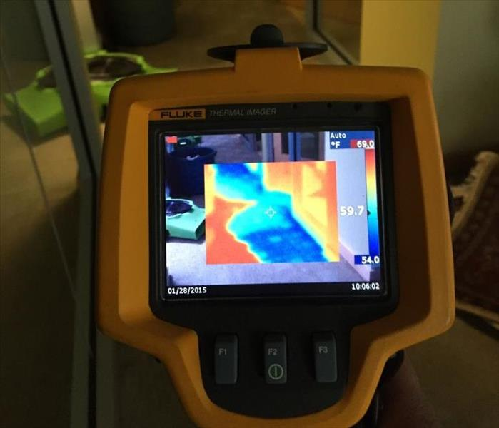 Infrared camera finding hidden moisture in walls