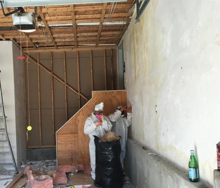 SERVPRO technicians with PPE during demolition