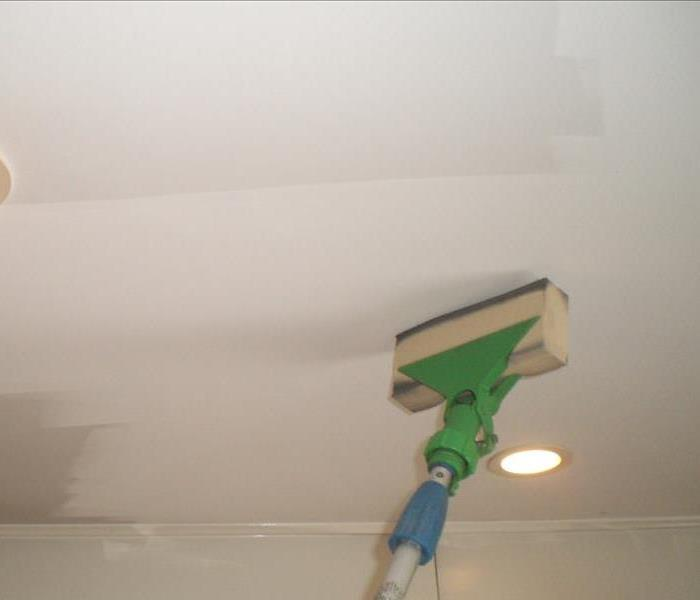 Soot cleanup on a ceiling
